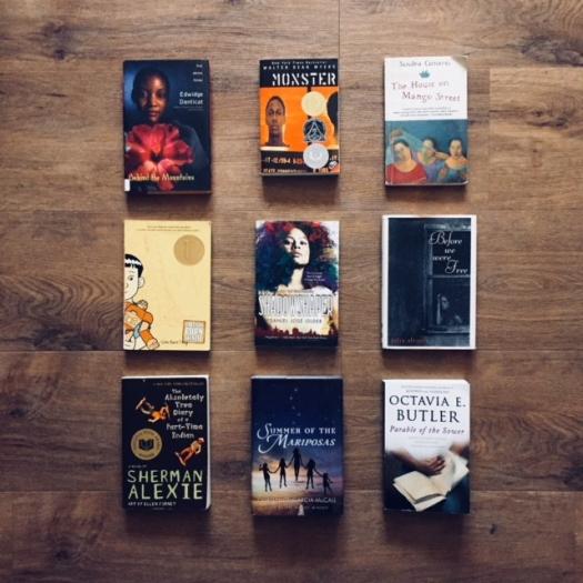 nine young adult books on hardwood floor