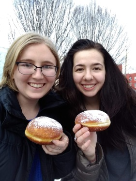 Two girls holding paczkis