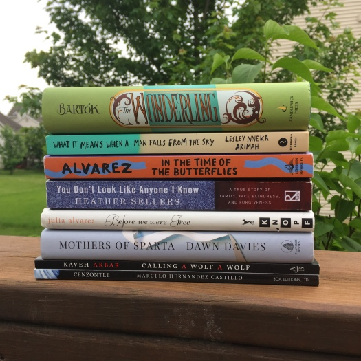 stack of books sitting outside